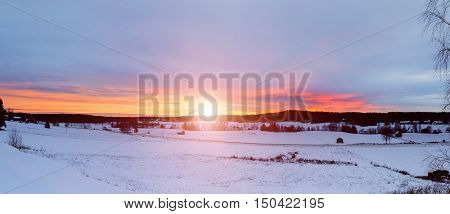 Winter sunset landscape with dramatic sky in Sweden, north scandinavian seasonal hipster background. Panoramic view