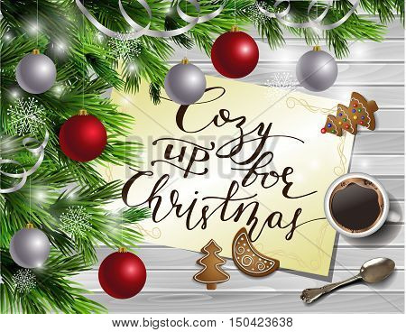 Christmas New Year design light wooden background with christmas tree and silver and red balls and handwritten Cozy up for Christmas coffee teaspoon and gingerbread
