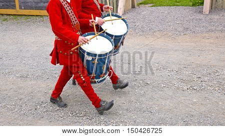 Two Marching drummers in Period Costumes at Fortress of Louisbourg, Parks Canada Historic Site, Nova Scotia