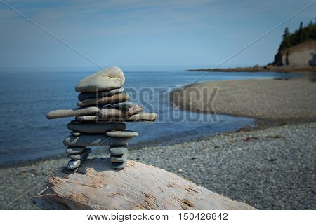 Inukuk standing on a rock in gaspesie, Quebec. An inuksuk is a human-made stone landmark.