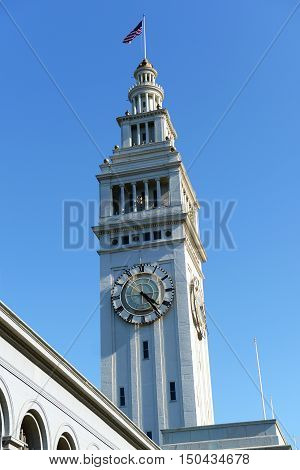 San Francisco Ferry Building at downtown San Francisco, California, USA. The clock tower is inspired by the Moorish bell tower of Seville Cathedral and the building is built between 1896 and 1903.