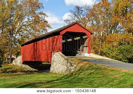 Pool Forge covered bridge in Fall, Lancaster County, Pennsylvania, USA.