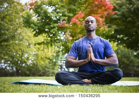 Young Man Exercising Yoga