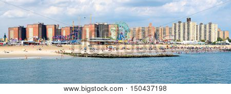 NEW YORK,USA - AUGUST 18,2016 : High resolution panoramic image of Coney Island beach and the Luna Park amusement park