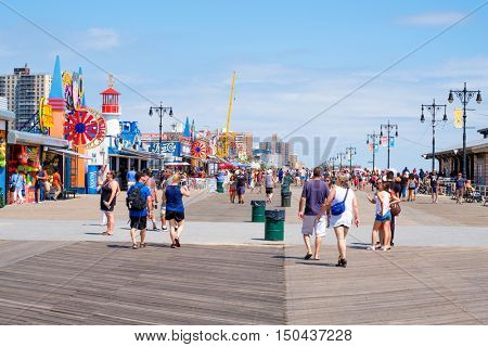 NEW YORK,USA - AUGUST 18,2016 : The Coney Island seaside boardwalk on a beautiful summer day