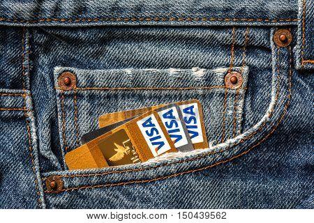 Tallinn, Estonia, September 28.2016. Plastic credit cards VISA gold  in jeans pocket