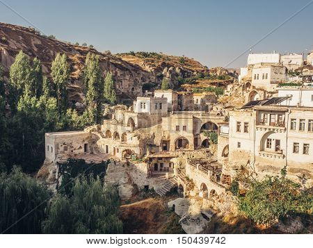ORTAHISAR CAPPADOCIA TURKEY - SEPTEMBER 16 2016: Ortahisar is famous for its friendly inhabitants picturesque stone houses narrow streets and lovely churches as well as the castle-like rock formation after which the town is named.