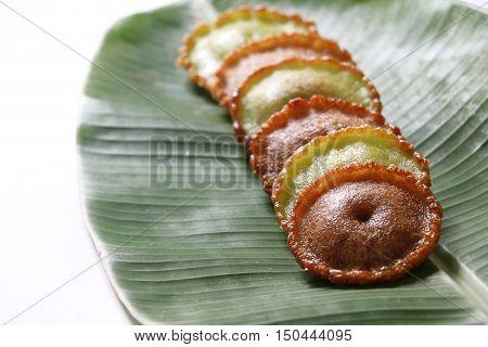 Malaysian traditional cake , Kuih Pinjaram or Penyaram on banana leaf