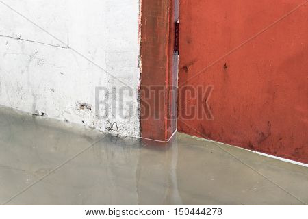 rain Water flooded that wall metal gate of a house
