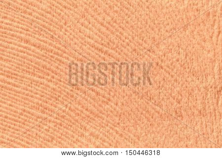 Coral background from a soft wool textile material closeup. Fabric with natural texture. Cloth backdrop.