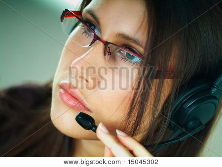 Girl with headset phone at a call center