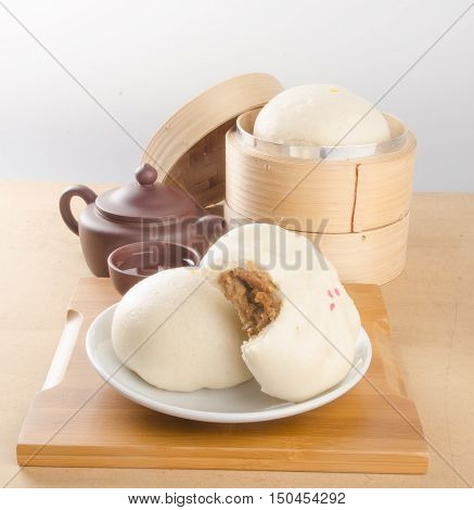 Pao Or Asian Buns On A Background.