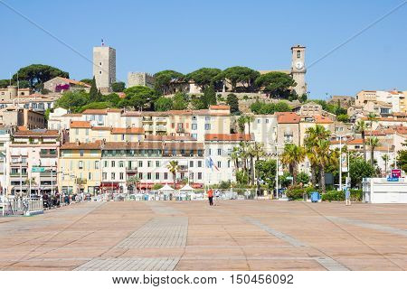 CANNES, FRANCE - JUNE 28, 2016: Tourists walking in the old port. The place is a departure point for the St Marguerite and St Honorat islands.