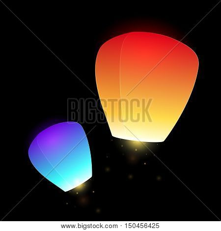 Set of blue and orange flying sky lanterns for your creativity