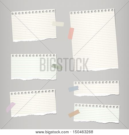 Pieces of light brown torn note, notebook paper sheets with colorful adhesive, sticky tape stuck on grey background.