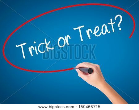 Women Hand Writing Trick Or Treat? With Black Marker On Visual Screen.
