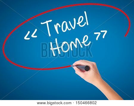 Women Hand Writing Travel - Home With Black Marker On Visual Screen