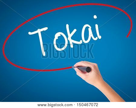 Women Hand Writing Tokai With Black Marker On Visual Screen