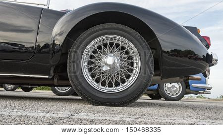 wheel with spokes of an ancient convertible car