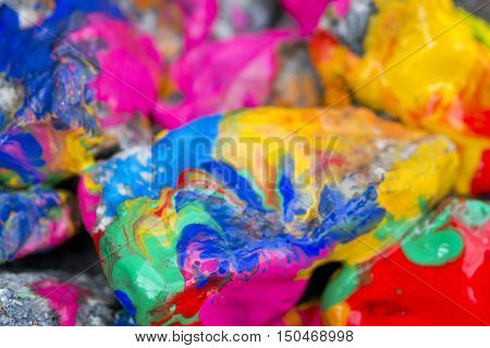 Abstract Background Bright Colored Stones With Paint Bizarre to Spread Paint on the Surface
