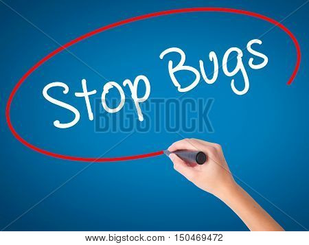 Women Hand Writing Stop Bugs With Black Marker On Visual Screen
