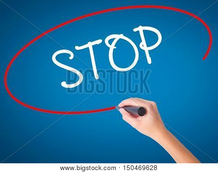 Women Hand Writing Stop With Black Marker On Visual Screen.