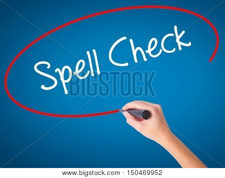 Women Hand Writing Spell Check  With Black Marker On Visual Screen