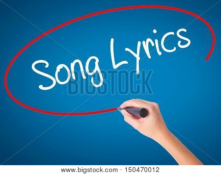 Women Hand Writing Song Lyrics With Black Marker On Visual Screen
