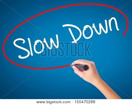 Women Hand Writing Slow Down With Black Marker On Visual Screen
