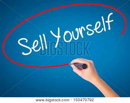 Women Hand Writing Sell Yourself With Black Marker On Visual Screen