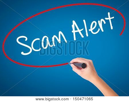 Women Hand Writing Scam Alert  With Black Marker On Visual Screen