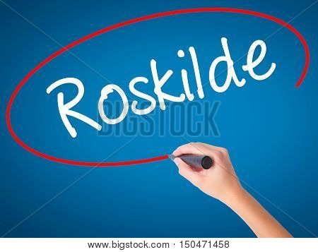 Women Hand Writing Roskilde With Black Marker On Visual Screen