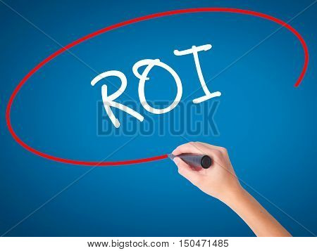 Women Hand Writing Roi (return On Investment)  With Black Marker On Visual Screen