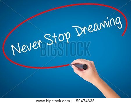 Women Hand Writing Never Stop Dreaming With Black Marker On Visual Screen