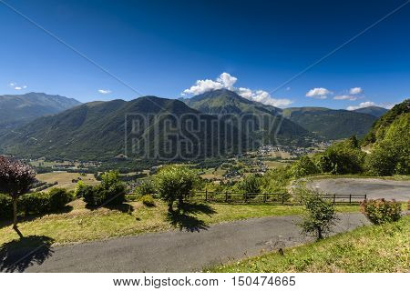 Valley And Peak Of Pyrenean Mountains With A Blue Sky, France