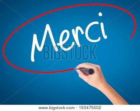 Women Hand Writing Merci  (thank You In French) With Black Marker On Visual Screen.