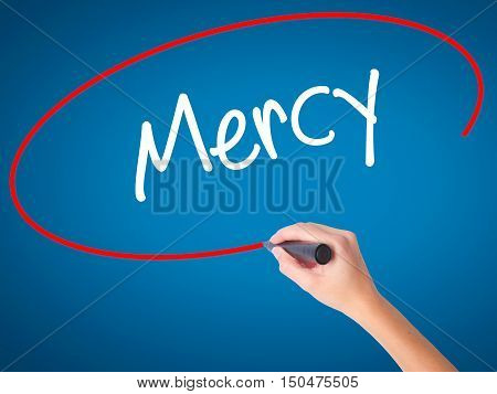 Women Hand Writing Mercy With Black Marker On Visual Screen