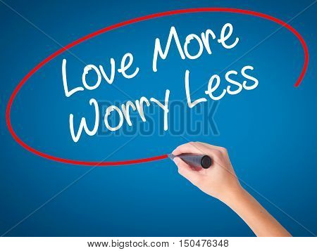Women Hand Writing Love More Worry Less With Black Marker On Visual Screen.