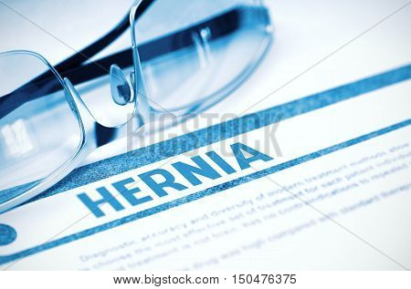 Hernia - Medicine Concept with Blurred Text and Glasses on Blue Background. Selective Focus. 3D Rendering.