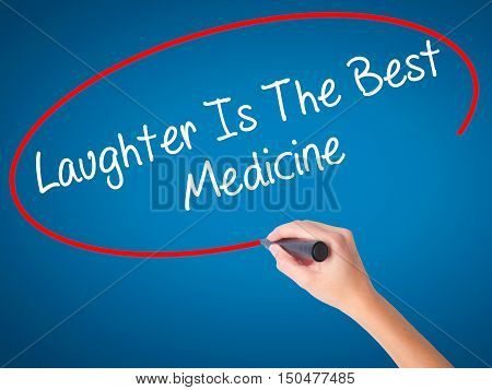 Women Hand Writing Laughter Is The Best Medicine  With Black Marker On Visual Screen
