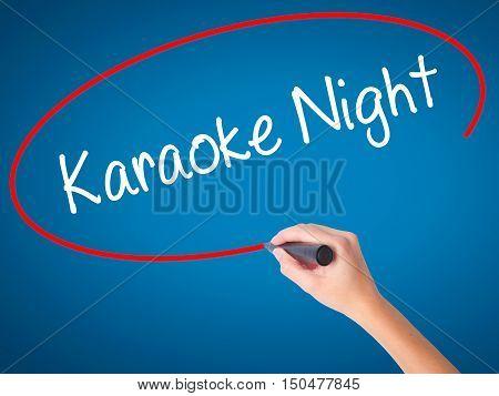 Women Hand Writing Karaoke Night With Black Marker On Visual Screen