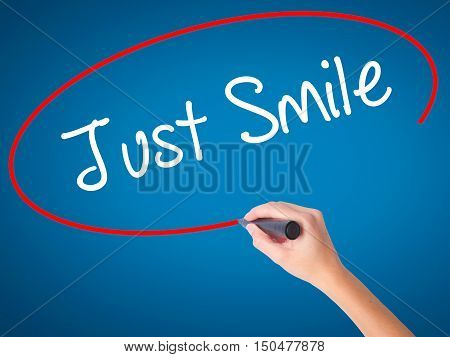Women Hand Writing Just Smile With Black Marker On Visual Screen