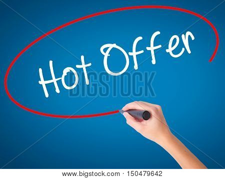 Women Hand Writing Hot Offer With Black Marker On Visual Screen.