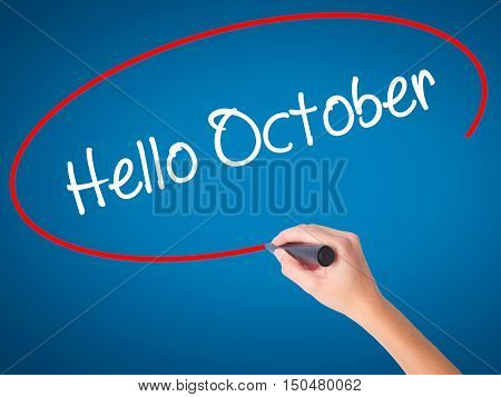 Women Hand Writing  Hello October  With Black Marker On Visual Screen