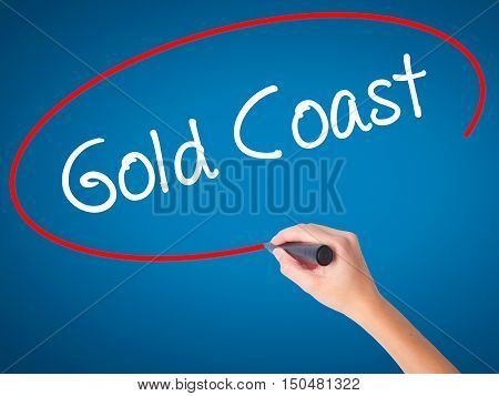 Women Hand Writing Gold Coast With Black Marker On Visual Screen
