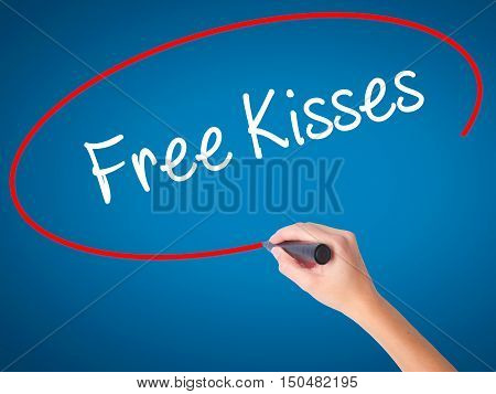 Women Hand Writing Free Kisses  With Black Marker On Visual Screen