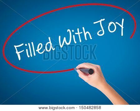 Women Hand Writing Filled With Joy With Black Marker On Visual Screen