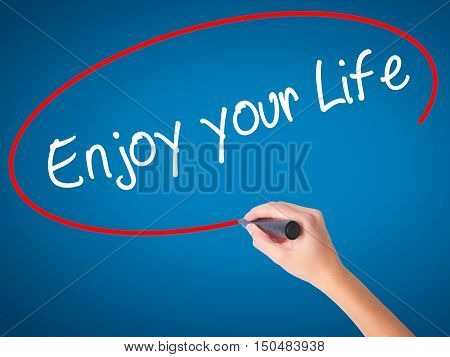 Women Hand Writing Enjoy Your Life With Black Marker On Visual Screen