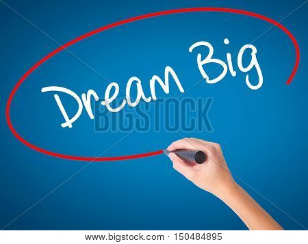 Women Hand Writing Dream Big  With Black Marker On Visual Screen