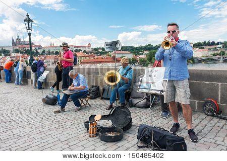 PRAGUE CZECH REPUBLIC - JUNE 27 2016: Street music band performing on famous Charles bridge in Prague Czech Republic